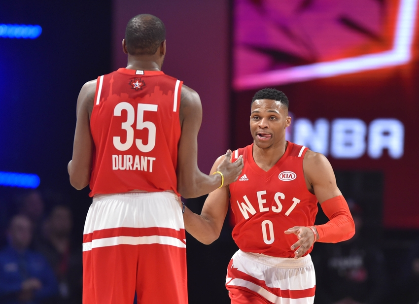 acf25d908798 ... guard Russell Westbrook of the Oklahoma City Thunder (0) reacts with  teammate Kevin Durant (35) in the second half during the NBA All Star Game  at Air ...